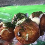 Because in Japan they eat Takoyaki at a baseball game (500yen)
