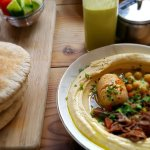 Hummus with slow cooked beef and a magic egg