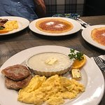 Turkey sausage scrambled eggs grits in pancakes wonderful meal for a great price and excellent s