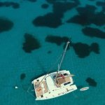 View down on the yacht from the drone. Us chillin on the front