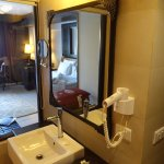 There is a glass window between room and bathroom and a roller curtain is available.
