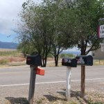 Sign with Grand Mesa in the background