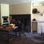 1850s kitchen with bee-hive oven, cast-iron stove, and servant call bells.
