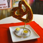 Bavarian Pretzel served with a Stella Artois gouda cheese dip, & sweet and spicy mustard