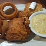 dark fried chicken, onion rings, creamy corn, jalepeno bread