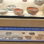 Pottery exhibit with labels beneath the pots