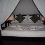 Four-poster bed decorated for our honeymoon