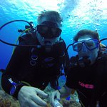 Bud and Miriam diving together at 80 feet