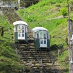 Cable Cars Passing on Tracks