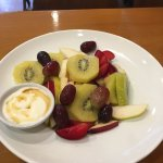 Fresh fruit salad with yogurt and honey