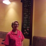 Miki of The Vineyard Trail in front of their port menu.