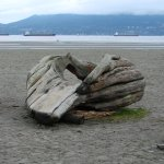A timber sculpture on the beach.