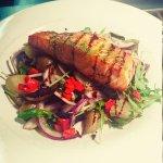 Pan Seared Salmon on Warm Potato, Rocket & Red Onion Salad with Herb Pesto