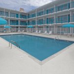 All guest rooms overlook the Outdoor Pool