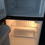Suppose to get free $10 per day minibar but as you can see it is empty and the freezer full of i