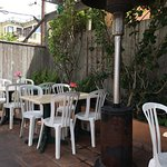 Cute patio to enjoy shrimp enchiladas for lunch with views of beach
