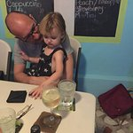 My son and granddaughter waiting for their food.
