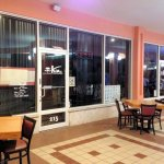 front of restaurant on second floor of strip mall