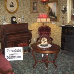 A Victorian parlor, an open place to sit and visit during your stay.