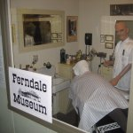 Town barbershop, lighted turning pole included. One of several authentic historical tableaux.