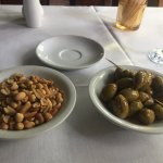 Complimentary Marinated Olives and Peanuts