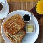 Coconut and oat french toast, Maya hot chocolate, fresh squeezed orange juice.