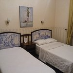 That on the right is a double bed - very narrow. The decorations with azulejos are anyway nice.