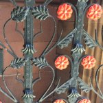 Wrought iron gate with red roses ( symbol of Lancaster.)