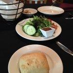 Salad that comes with the lunch, warm bread, papa a la Huancaina, & Pescado a lo macho.