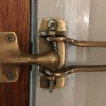 Room 213... closet door never replaced. Broken safety latch.