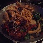 Sticky wings, lo-mein, veggies and dumplings