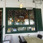 Window on facade of restaurant located in one of the original houses of the Moshava