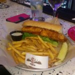 Delicious beer batter dipped haddock on a soft bun with fresh tarter sauce and perfectly cook fr
