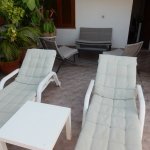 2 sun loungers and coffee table and chairs outside our room.