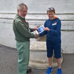 My son James being presented with a picture of Start Bay Lighthouse