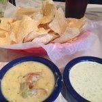 Nachos and cheese dip off the free happy hour nacho bar. Plus, free creamy jalapeño dipped I req