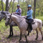 Embracing the beauty of a horseback ride in a natural setting