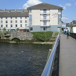 View of Jurys Inn from the bridge over the river