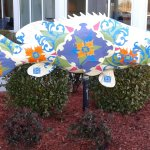 Colorful, artistic fish in front of hotel