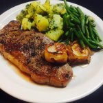 New York Strip Steak Special with 2 broiled bacon wrapped scallops