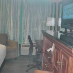 TV, desk and furniture in room 209