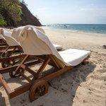 Comfy sun loungers on the beach