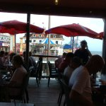 Great dining on the deck. Add a specialty drink and fresh fish.