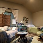 Living space within the bedroom, extra twin bed