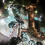 "View from our balcony of the ""lazy river"" pool at Tower 5 (night time)"