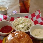crab cake sandwich with cole slaw and iced tea