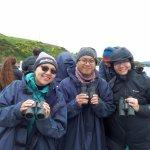 Raincoats and binoculars provided