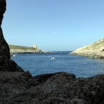 Xlendi Tower from the end of the railed cliff path