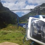 Landed helicopter before short walk to falls.