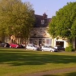 Entrance to The Fleece and the beautiful church green in front